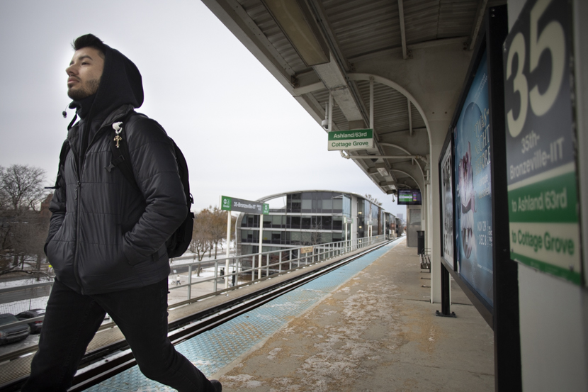 A commuter student exits the Green Line platform on 35th street