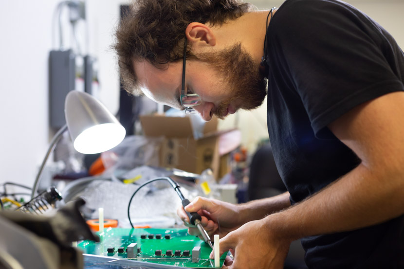 Photo of electrical engineering graduate student at work in a lab
