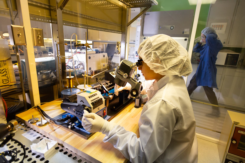 Photo of student at work in a clean room