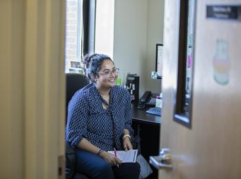 A Psychology alumna speaks to a patient in her office