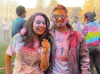 Two Illinois Tech students participating in the color run