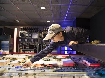 WISER - photo of person working on model of campus's smart grid