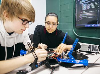 SAT - School of Applied Technology - photo of students working on drones