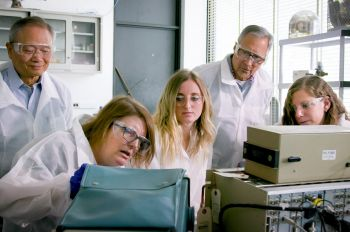Photo of students and faculty at work in physics radiation lab
