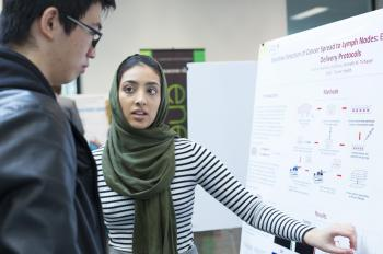 A student explains her summer research