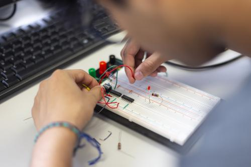 A student works on a circuitboard.