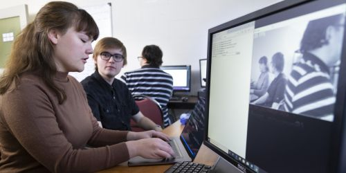 Students work on a mesh network research project in an ITM lab