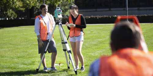 Students survey a plot of land for a civil engineering class