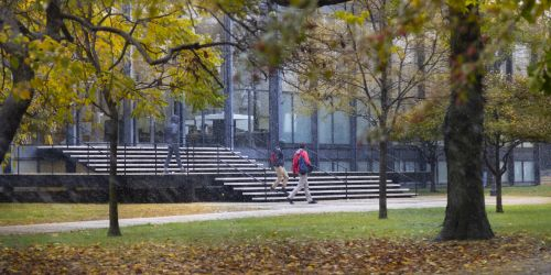 Students exit Crown Hall on a snowy fall day