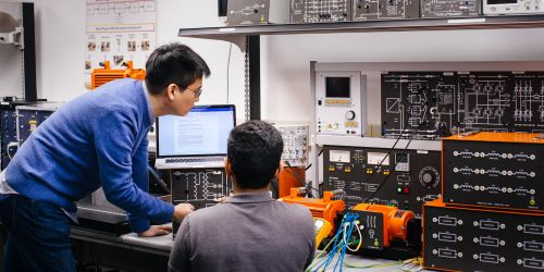 Photo of electrical engineering students at work in the Granger Lab