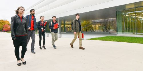 Multiple students walking on main campus