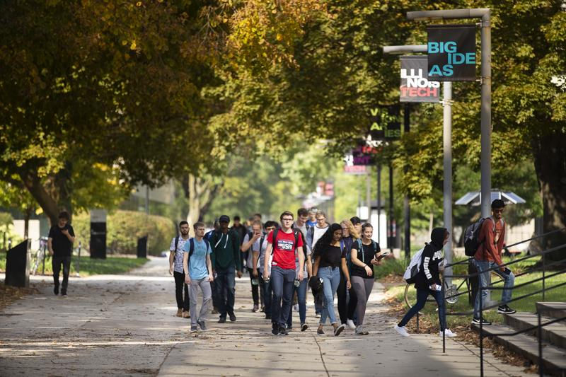 Students walk to class down the main stretch of campus