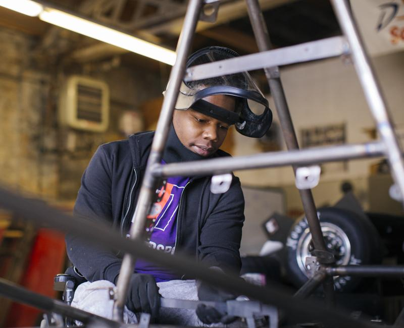 An Armour College of Engineering student works on racecar