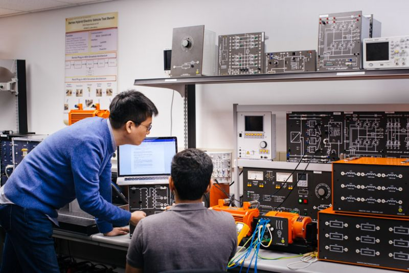 Photo of electrical engineering faculty and student in a lab