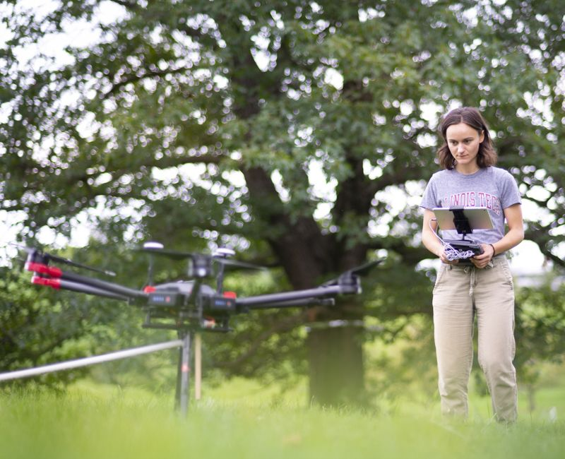 A student does tree research using drones at Armour College of Engineering