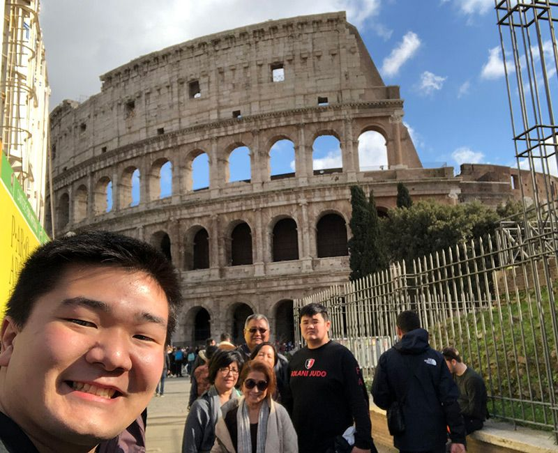 Dane Yamashiro (EE/M.S. EE 4th Year) with his family visiting Rome's Colosseum